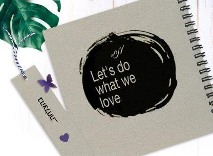 """מחברת מטרות אישית, עם שם ומשפט השראה: """"Let's Do What We Love"""""""